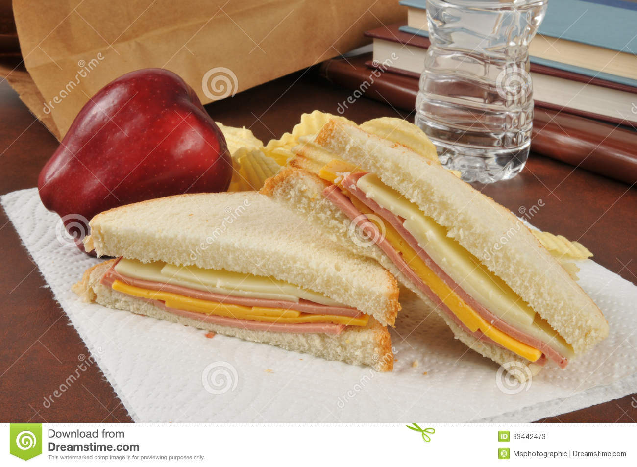 bologna and cheese sandwich sack lunch with an apple, potato chips ...