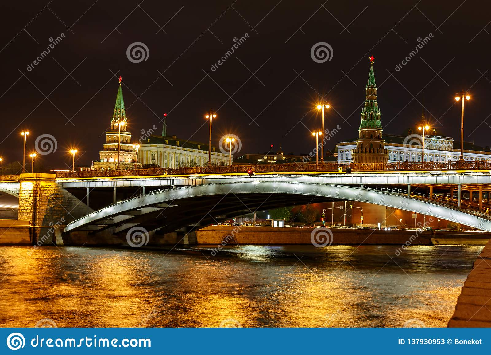 Bolshoy Kamenny Bridge on Moskva river against Moscow Kremlin towers