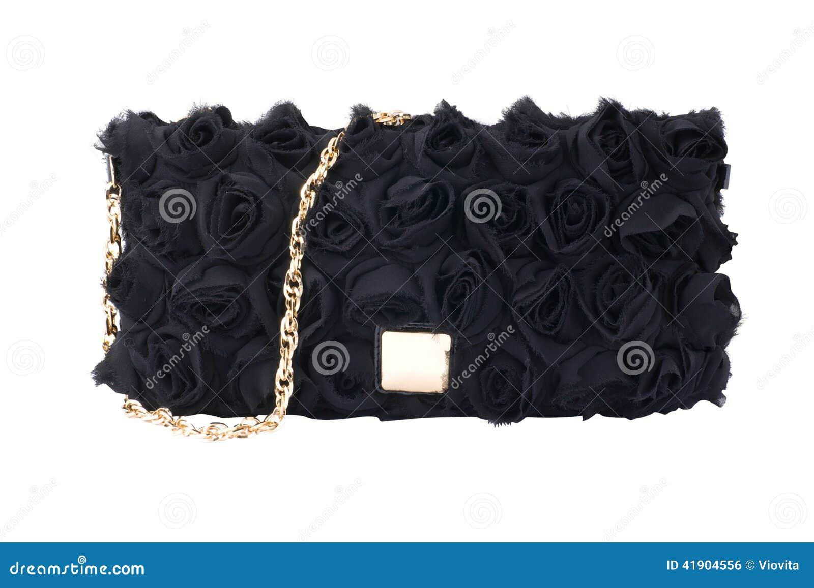 Bolso de la mujer aislado en blanco
