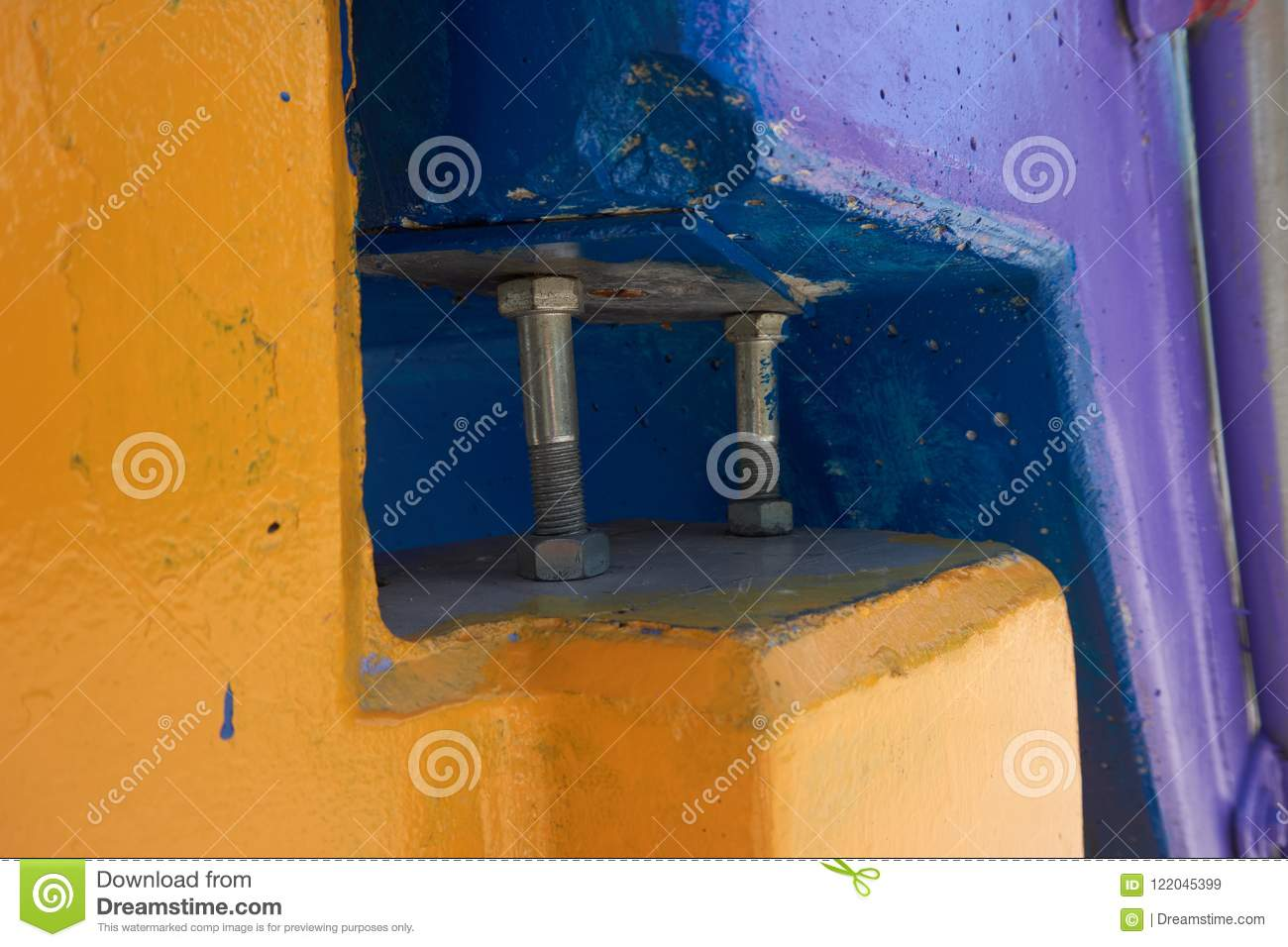 Bolts in between yellow and blue objects