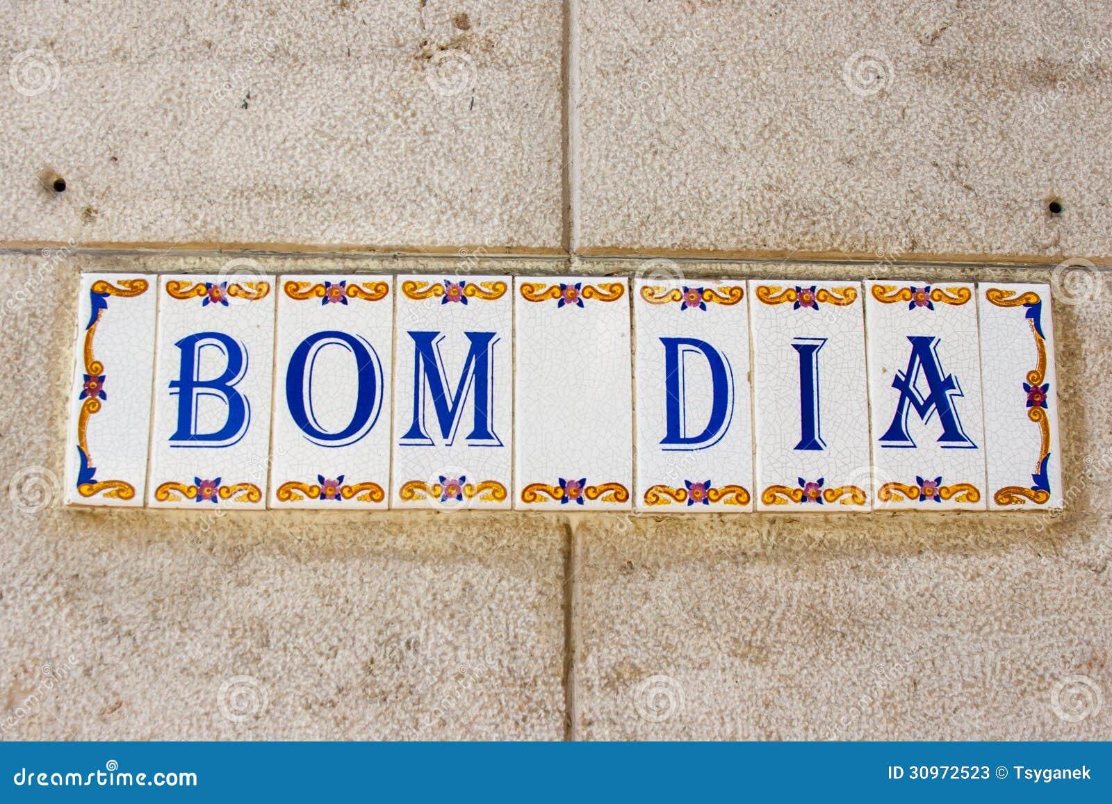 Bom Dia: Bom Dia (Good Morning) Tiles On A Building In Lisbon Stock