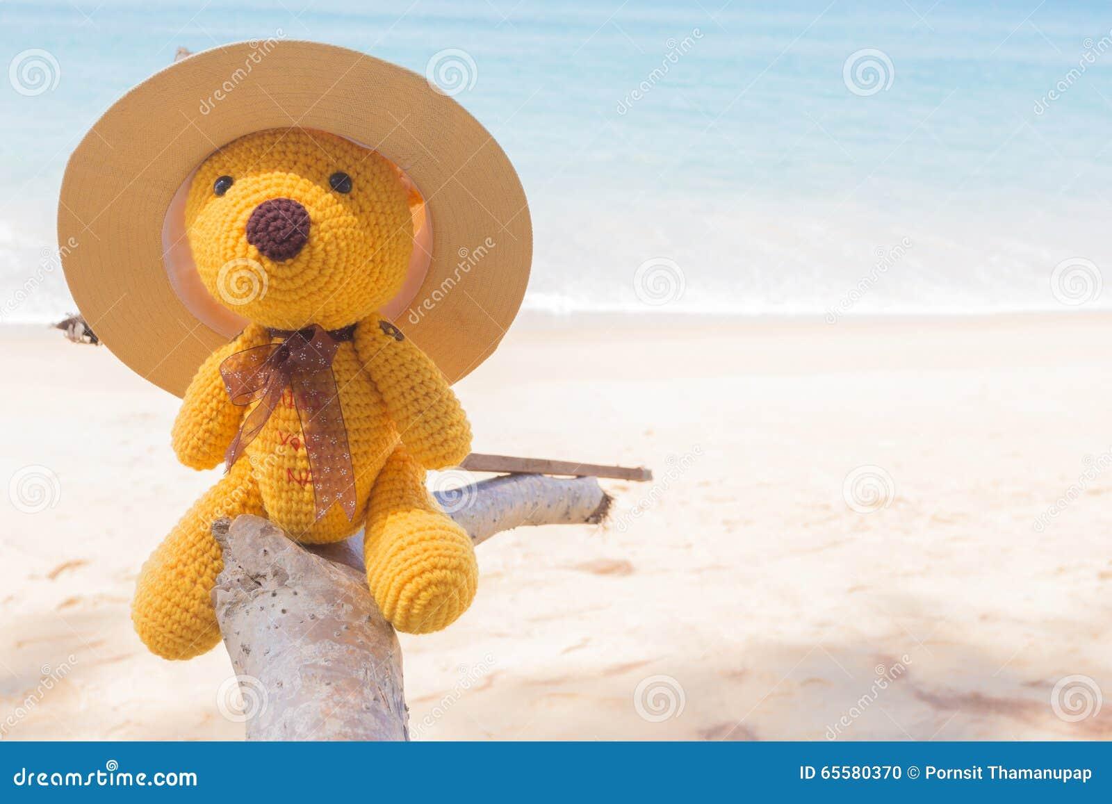 Boneca e mar do urso