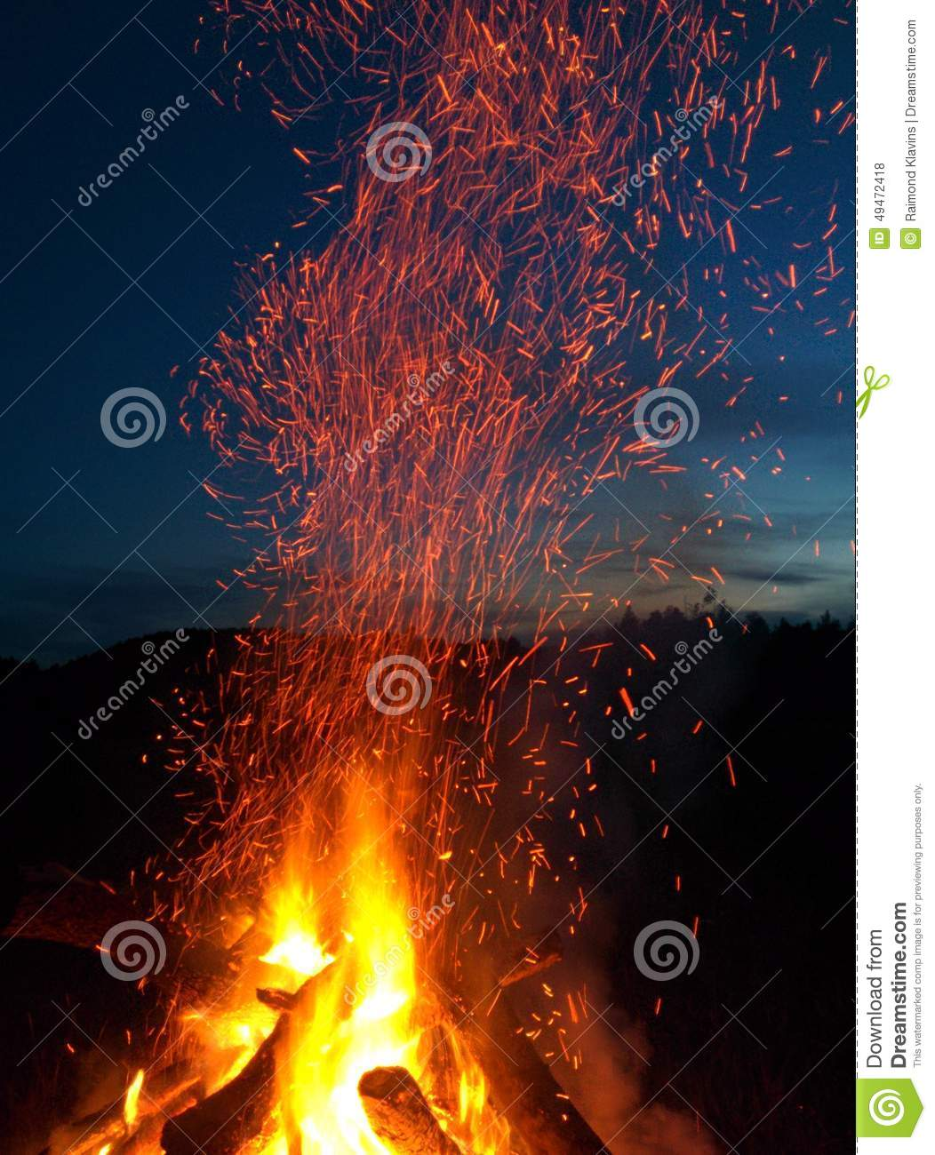 Bonfire with sparks at night summer time