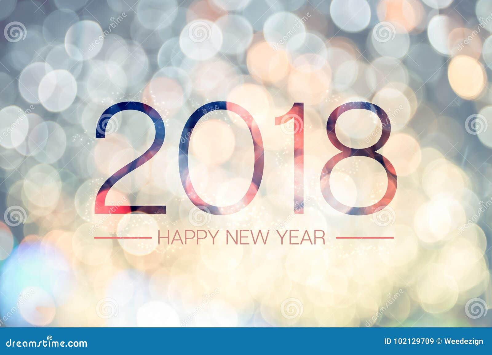 Bonne année 2018 avec le backg de scintillement léger de bokeh jaune pâle