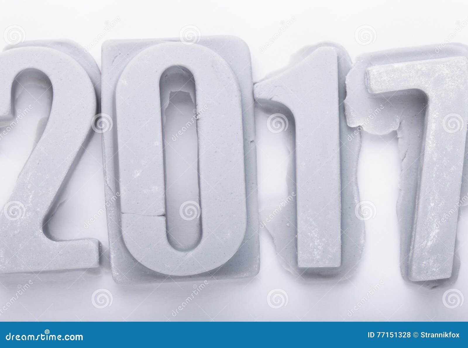 Bonne année 2017 sur le bacground blanc Figures de mastic ou d escroquerie