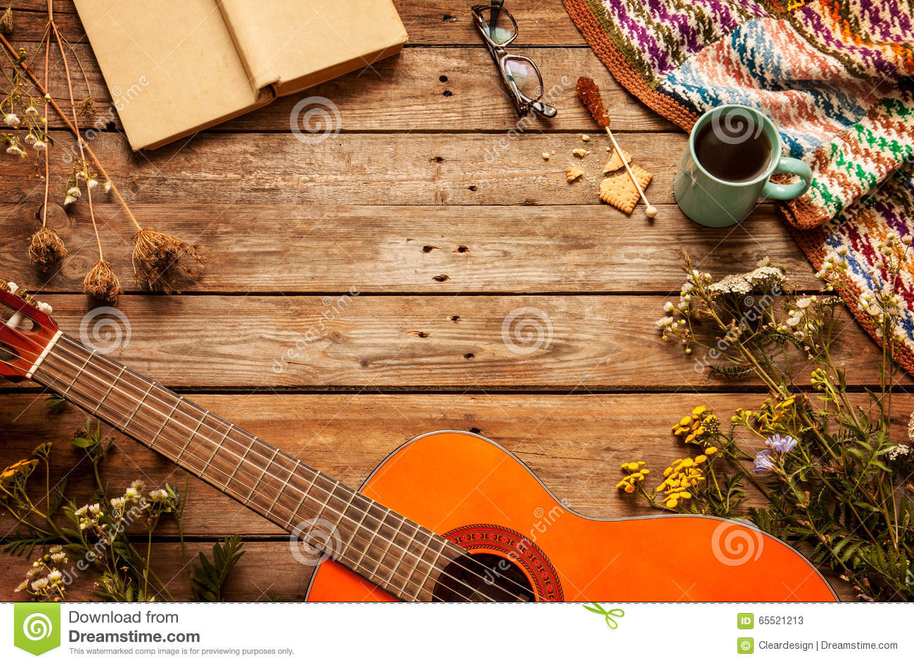 Book, blanket, coffee and classic guitar on wood