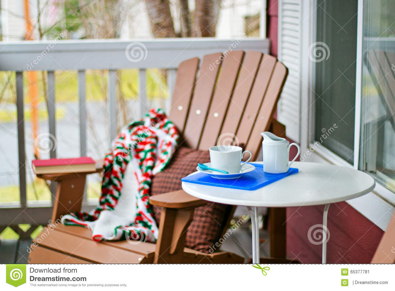 Book and coffee on a cozy porch stock photo image 65377781 for Cup cozy pillow