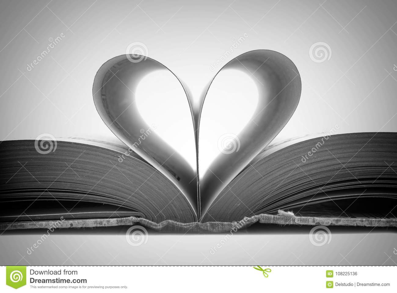 Book pages in the shape of a heart black and white stock photo