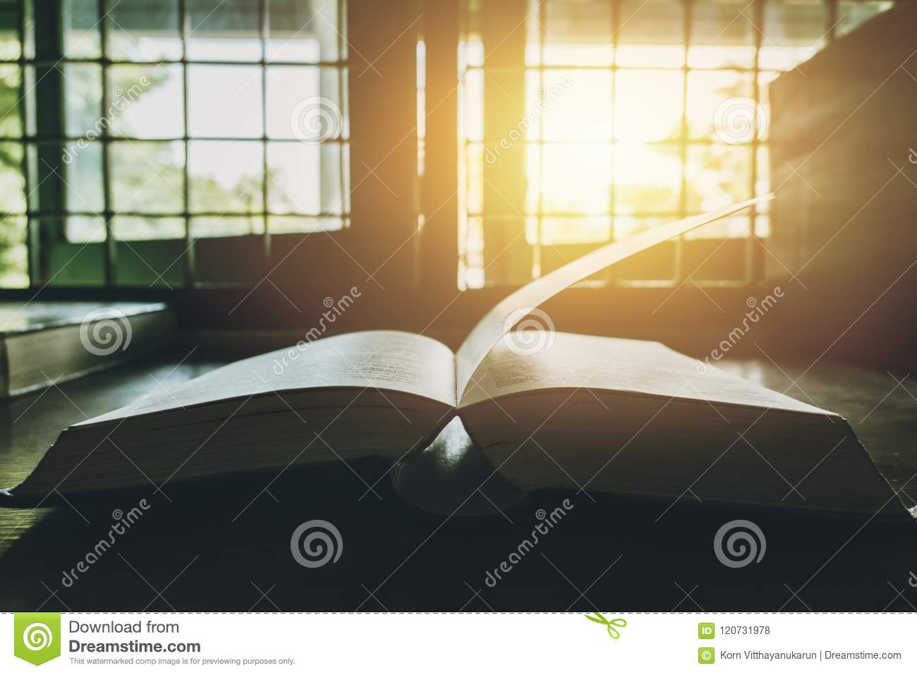 Book at the windows sun bright light through window