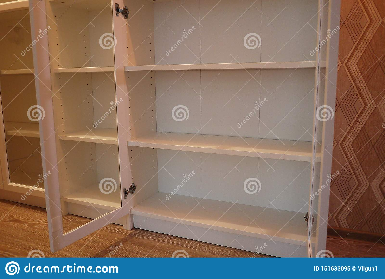 Bookcase in the interior of the apartment.