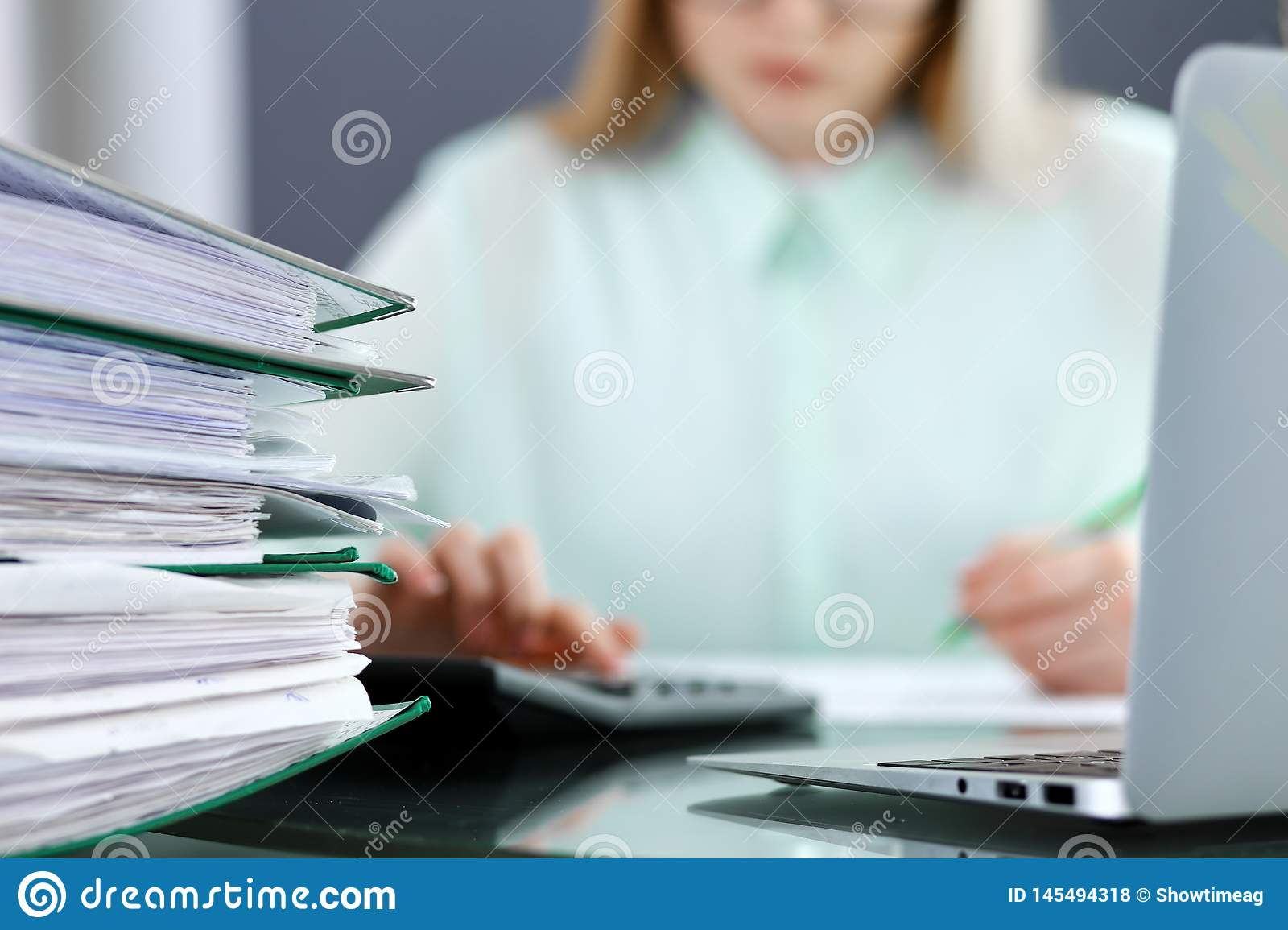 Bookkeeper or financial inspector making report, calculating or checking balance. Audit and tax service concept. Green