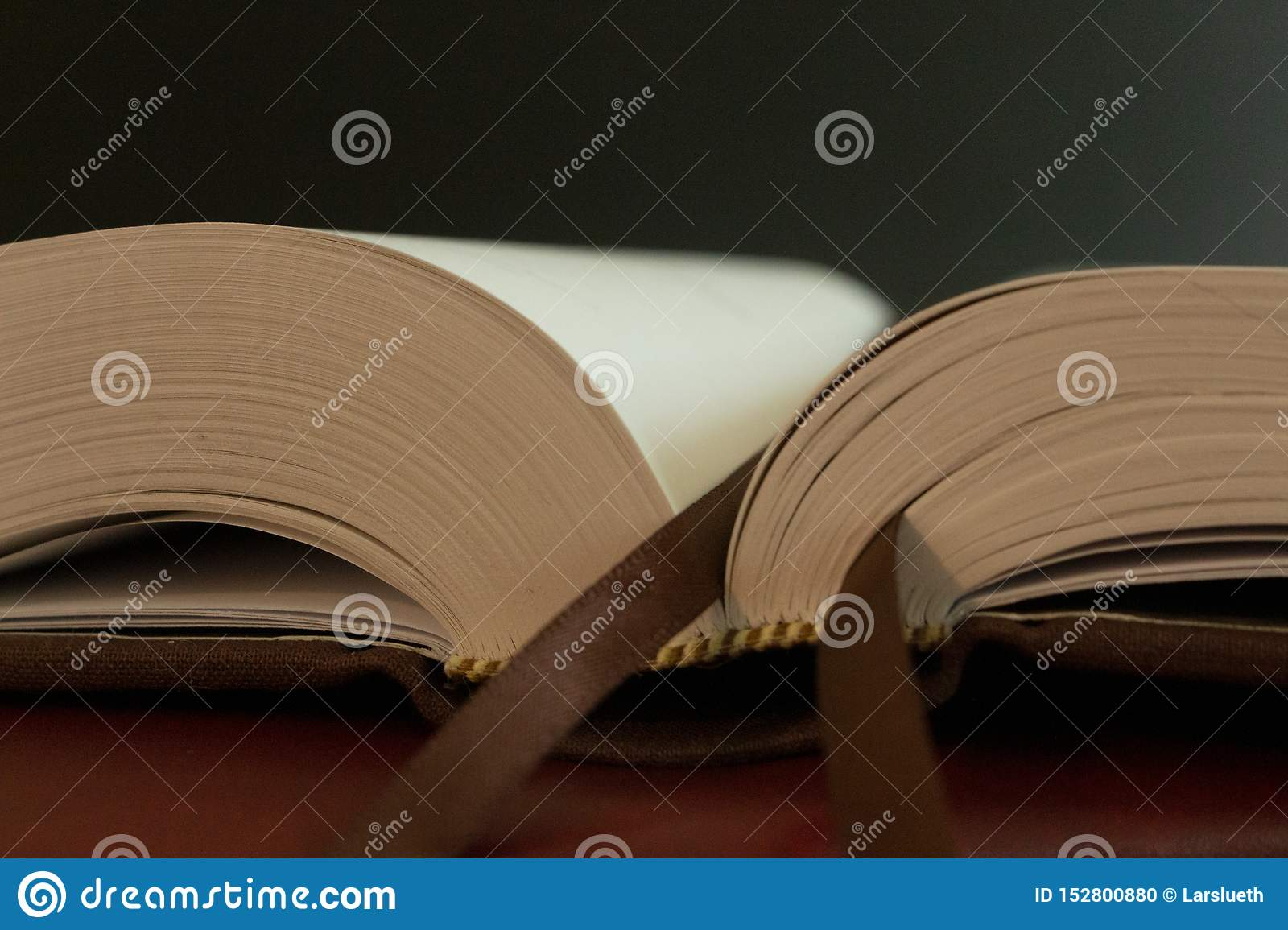 A bookmark on the pages of an open book