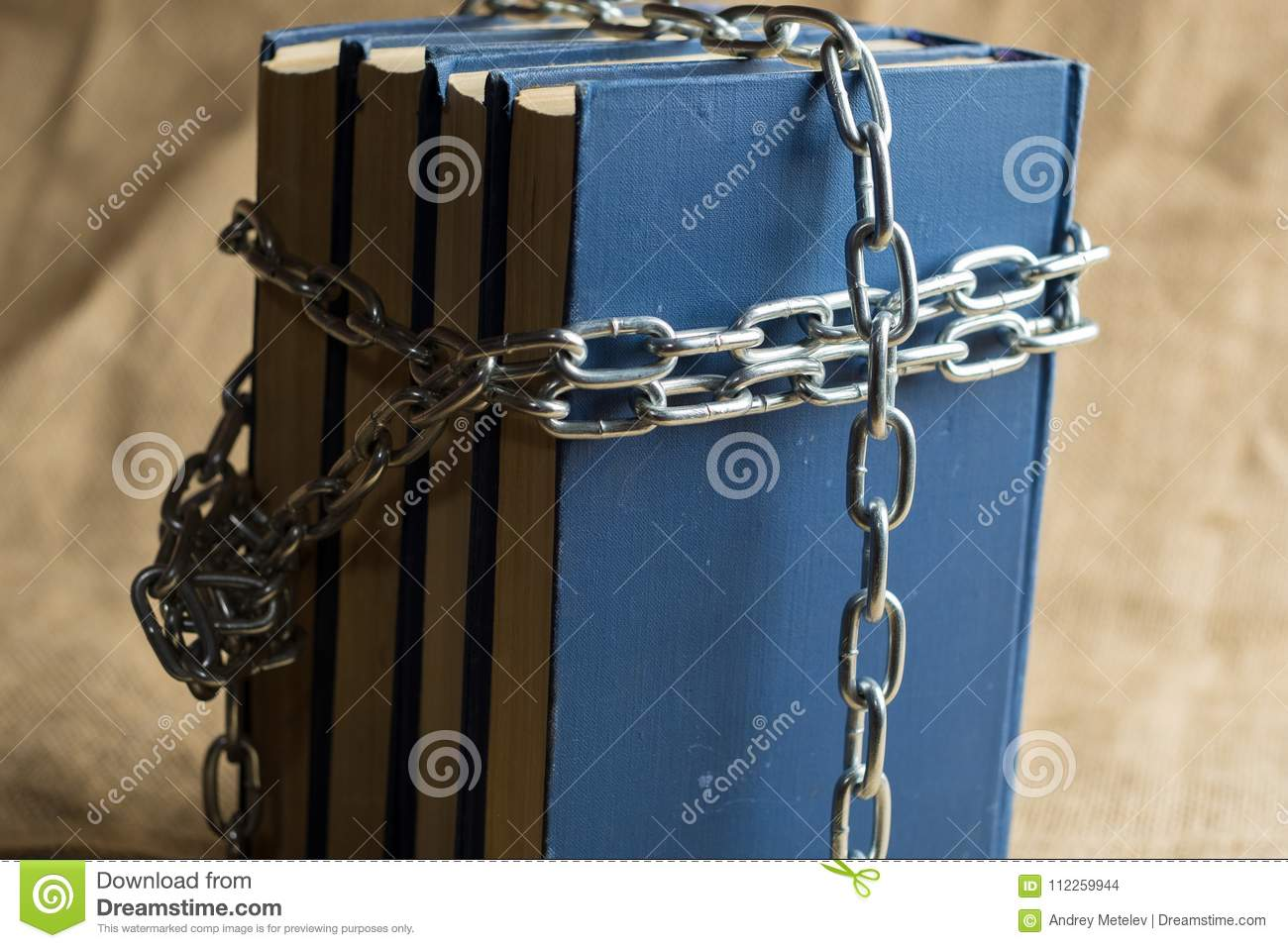 Books In Blue Binding Are Covered With A Chain Of Metal, A Chain In ...