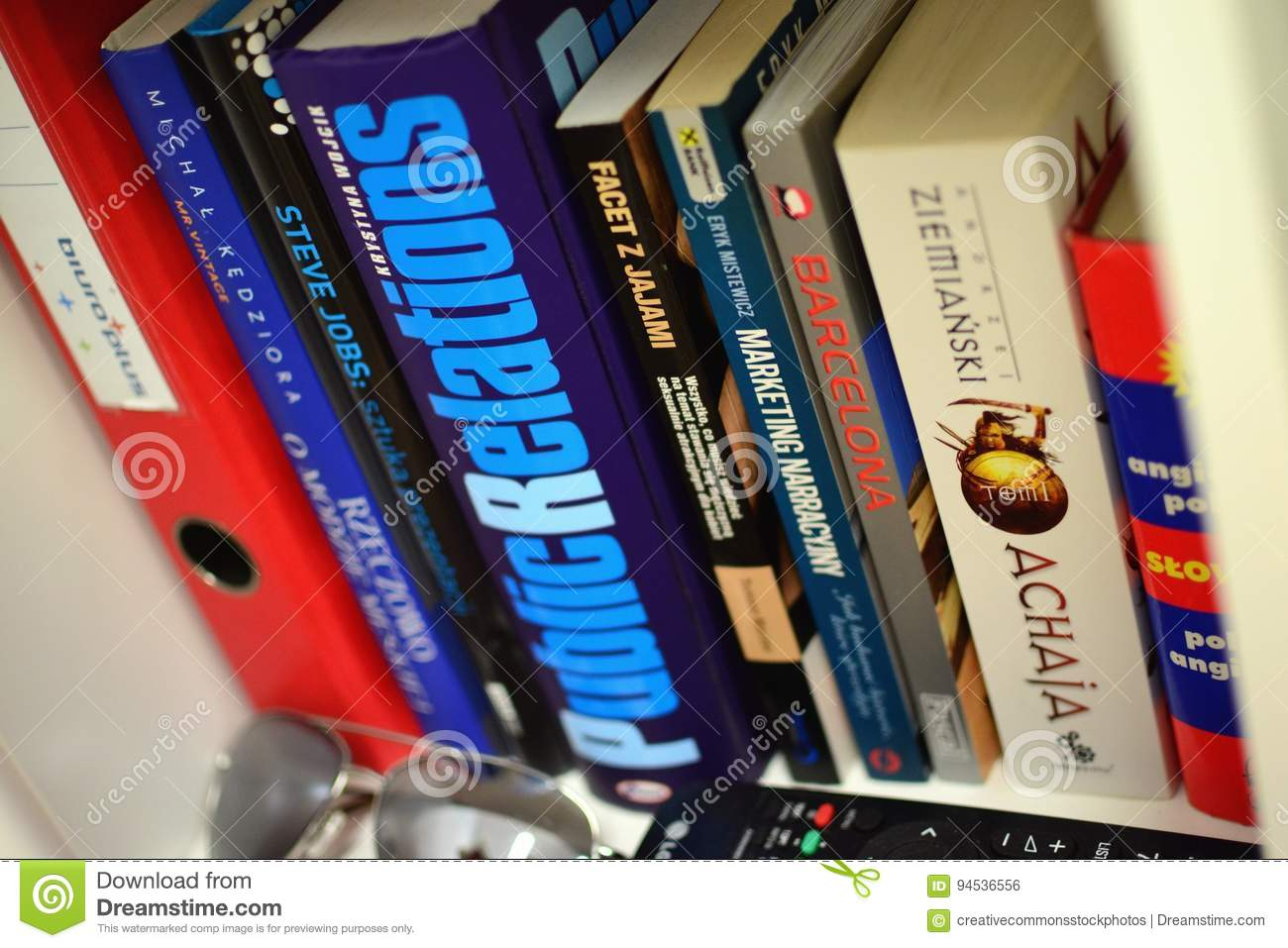 A Bookshelf With Books And Other Items