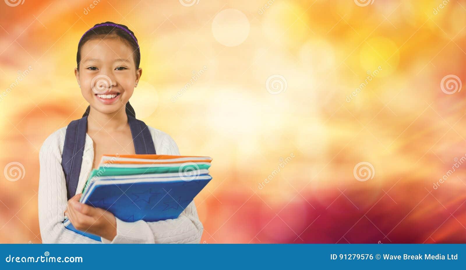 Books den lyckliga holdingen för flickan som isoleras över le white för skolaserie
