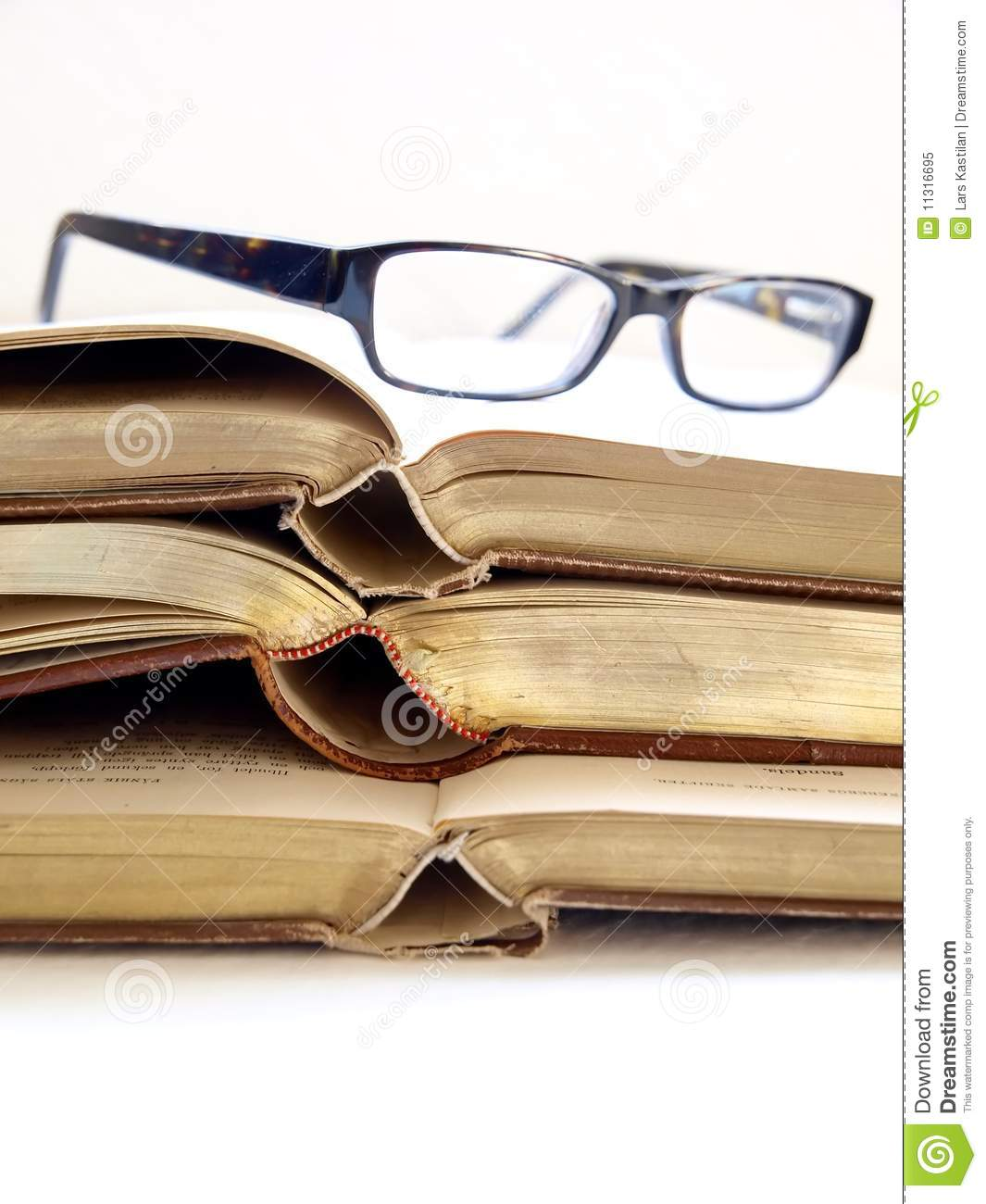 glasses on book - photo #37