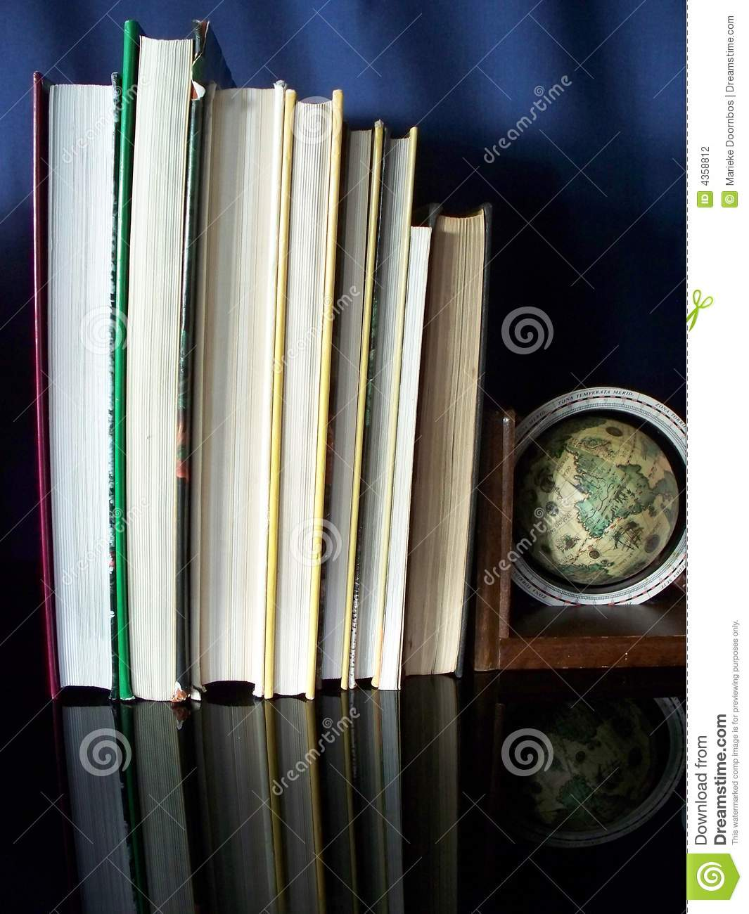Image of books and magnifying glass on a table close up for Mirror books