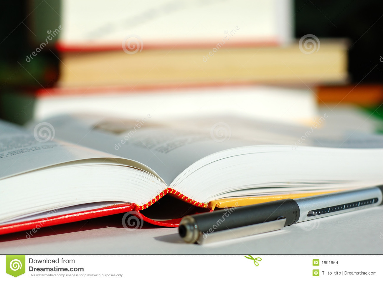 Books And Pen Stock Images