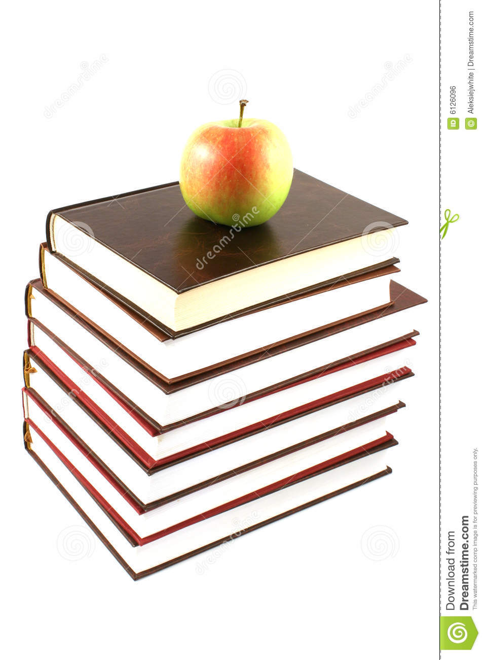Books pyramid with apple
