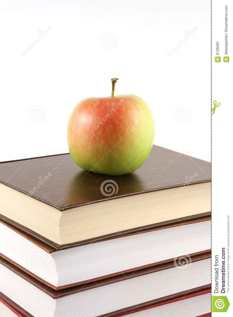 Books pyramid with apple on top