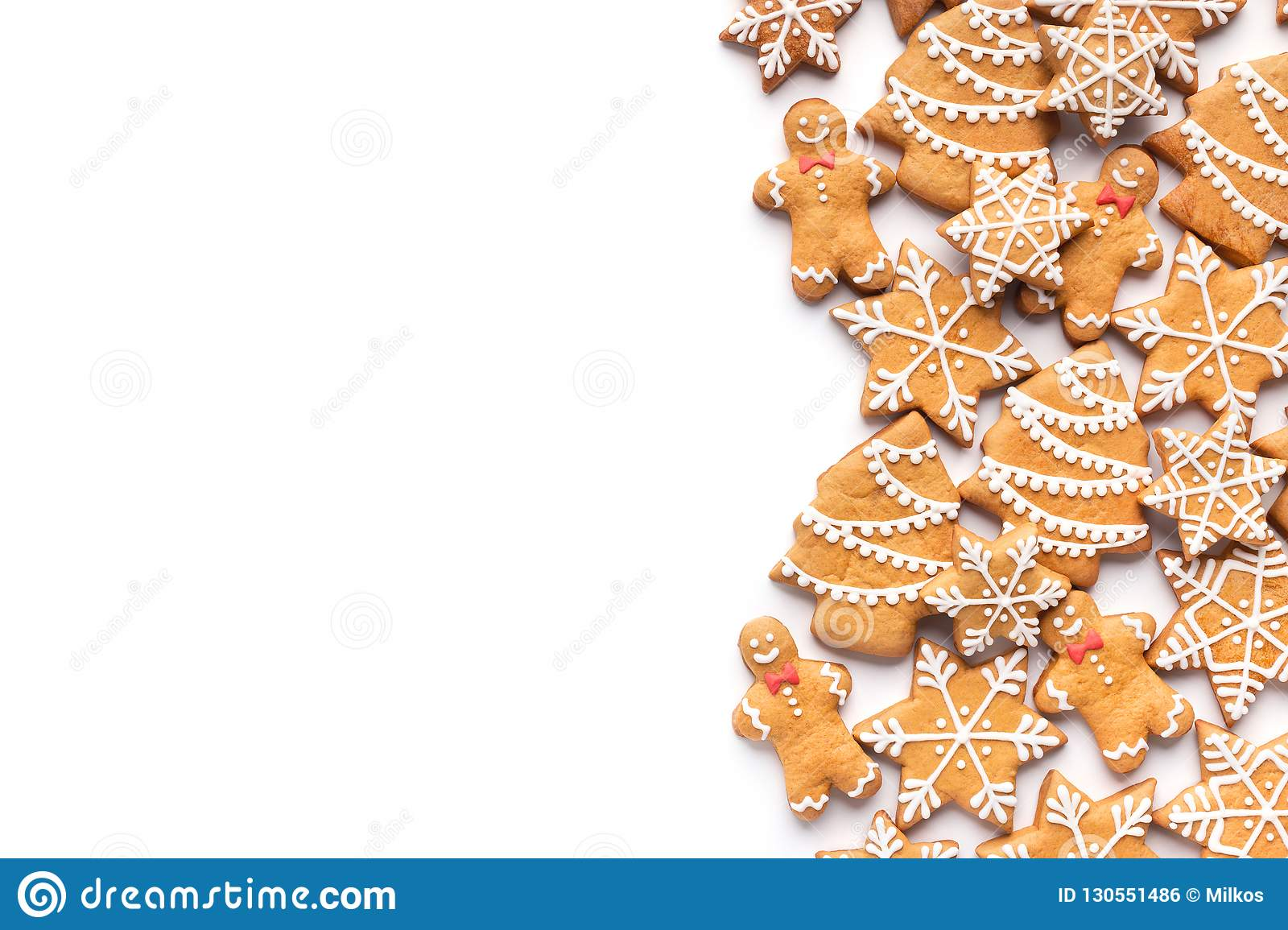 Border of homemade christmas gingerbread cookies on white