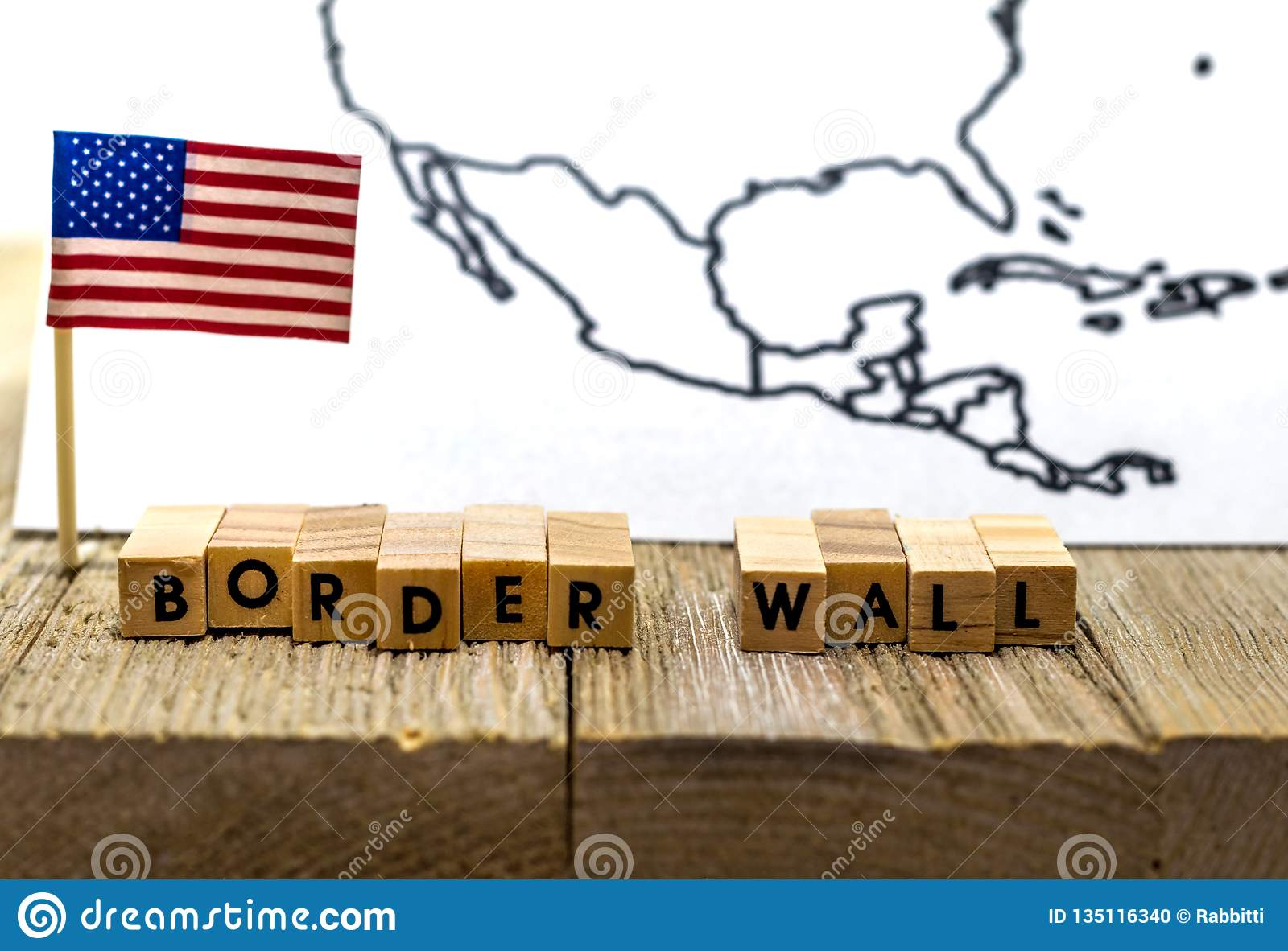 Border Wall USA concept with American flag on white background and wooden board