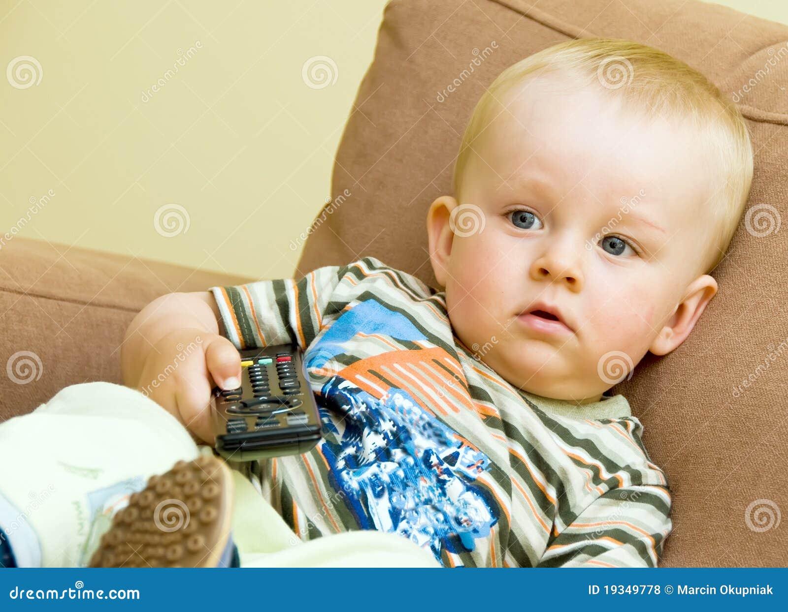 Bored boy watching TV