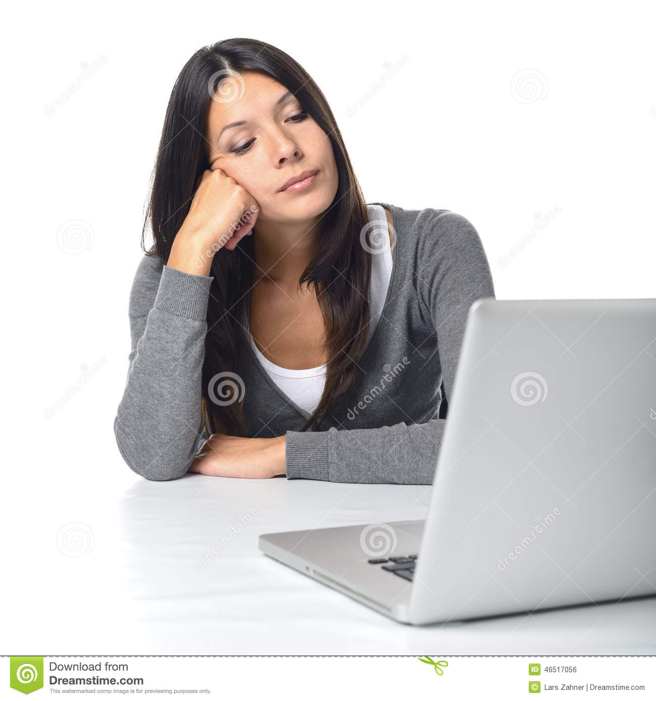 bored businesswoman staring at her laptop computer stock photo