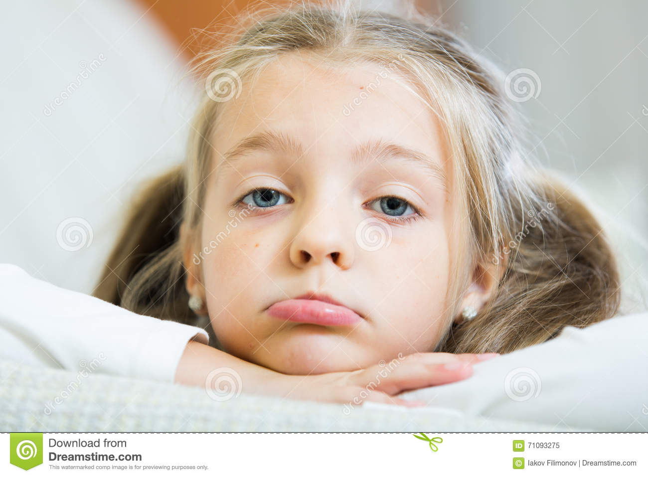 Bored little girl being lonely in couch at home stock for Home interior picture little girl