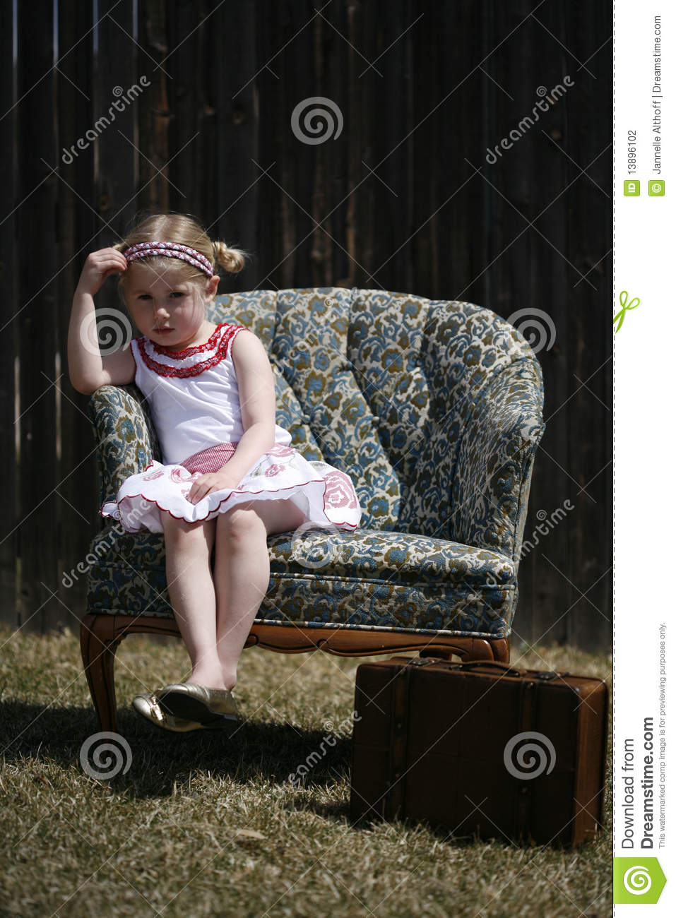 Bored Little Girl Sitting In A Chair Stock Photography