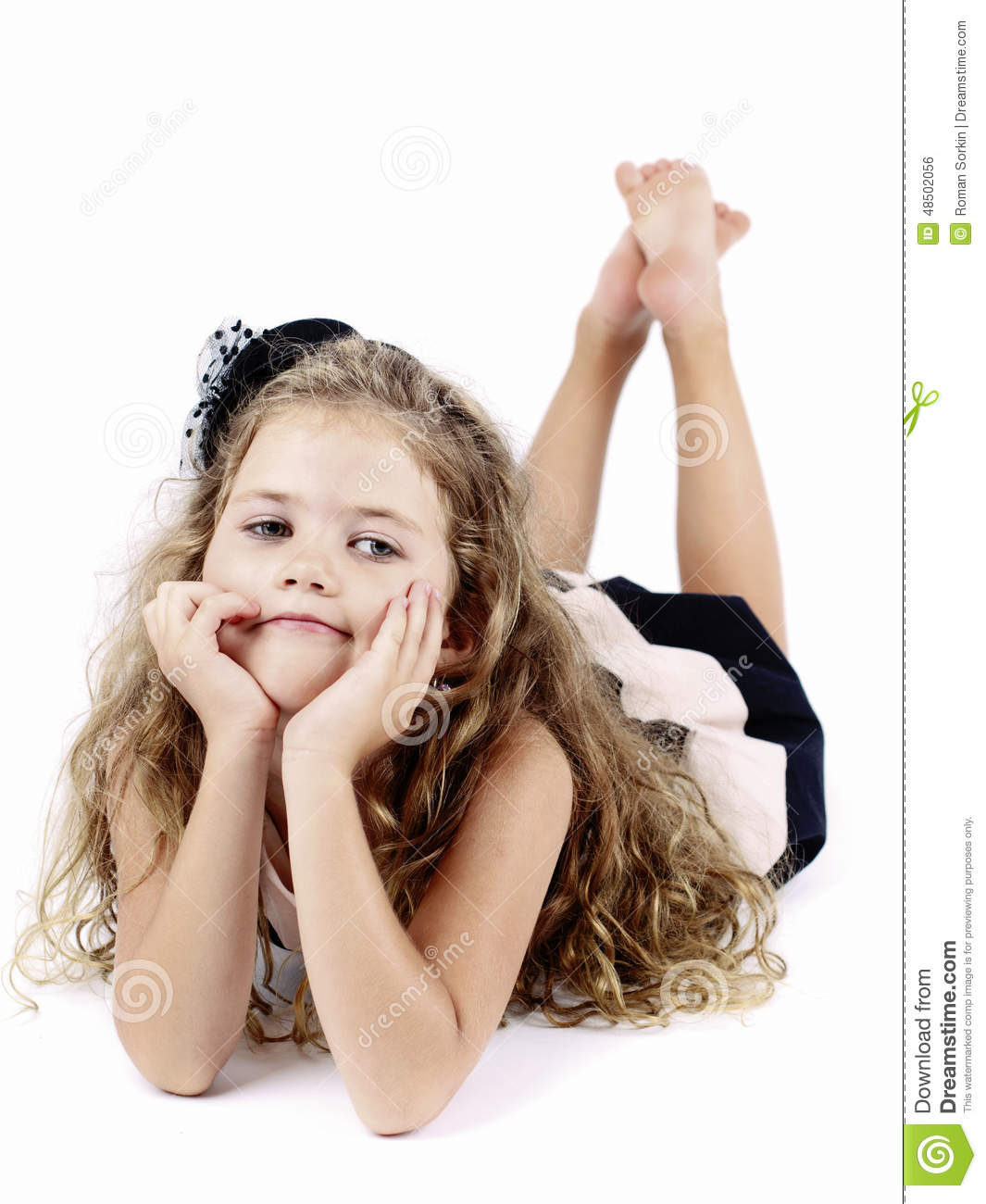 Bored Rich Little Girl Lying On The Floor Stock Photo ...
