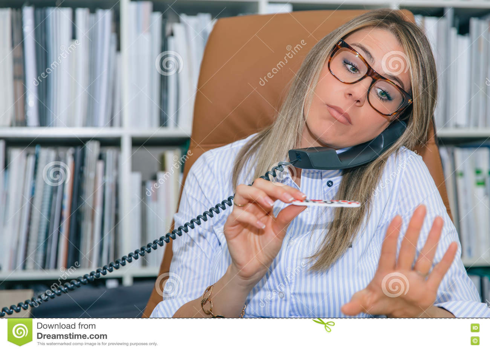 bored-secretary-polishing-nails-talking-