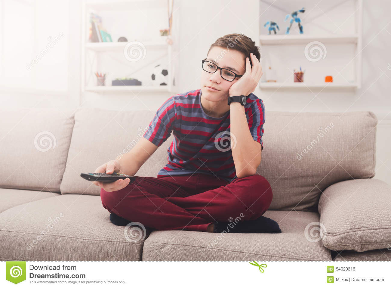 Bored Teenage Boy Watching Tv At Home Stock Photo - Image of console ...