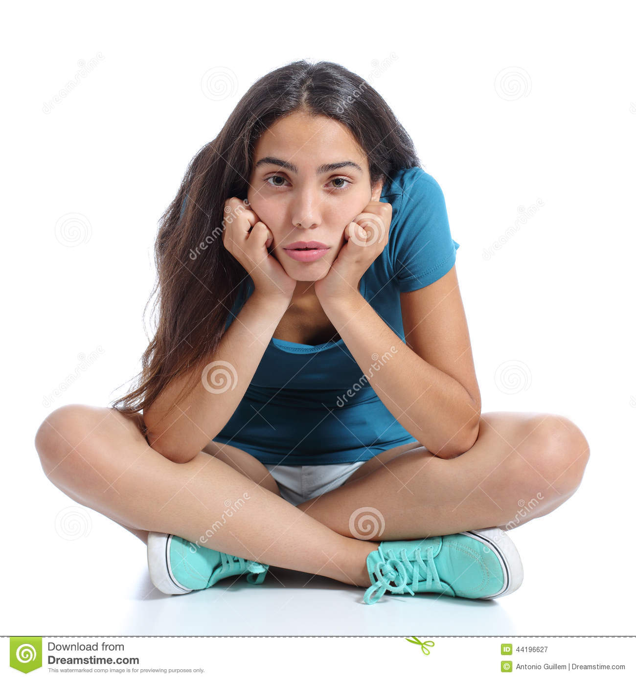 Bored Teenager Girl Sitting With Crossed Legs Stock Image