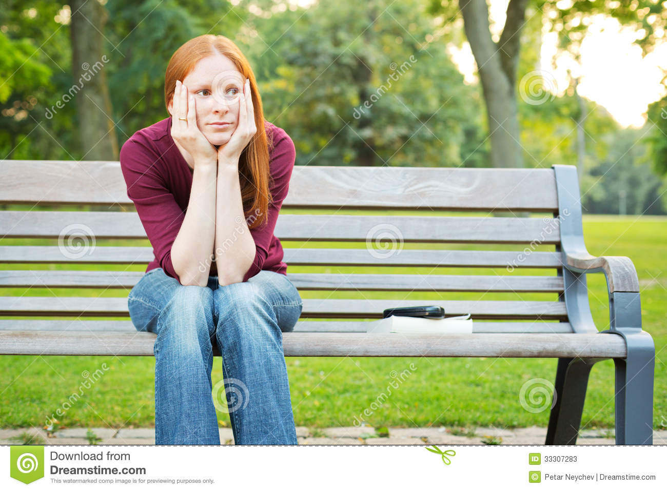 Bored Woman Sitting On A Bench Stock Photos - Image: 33307283
