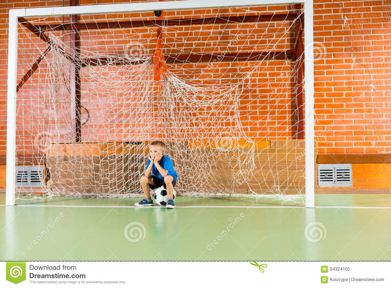Bored Young Boy Waiting On An Indoor Soccer Court Stock Photo ...