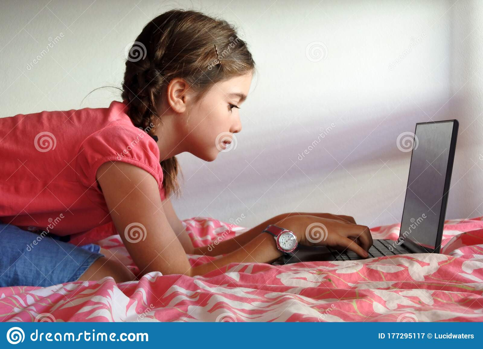 Bored Young Girl Age 10 Using A Laptop In Bedroom While Forced To Stay At  Home Because Government Policies Efforts To Prevent Stock Image - Image of  academic, bored: 177295117
