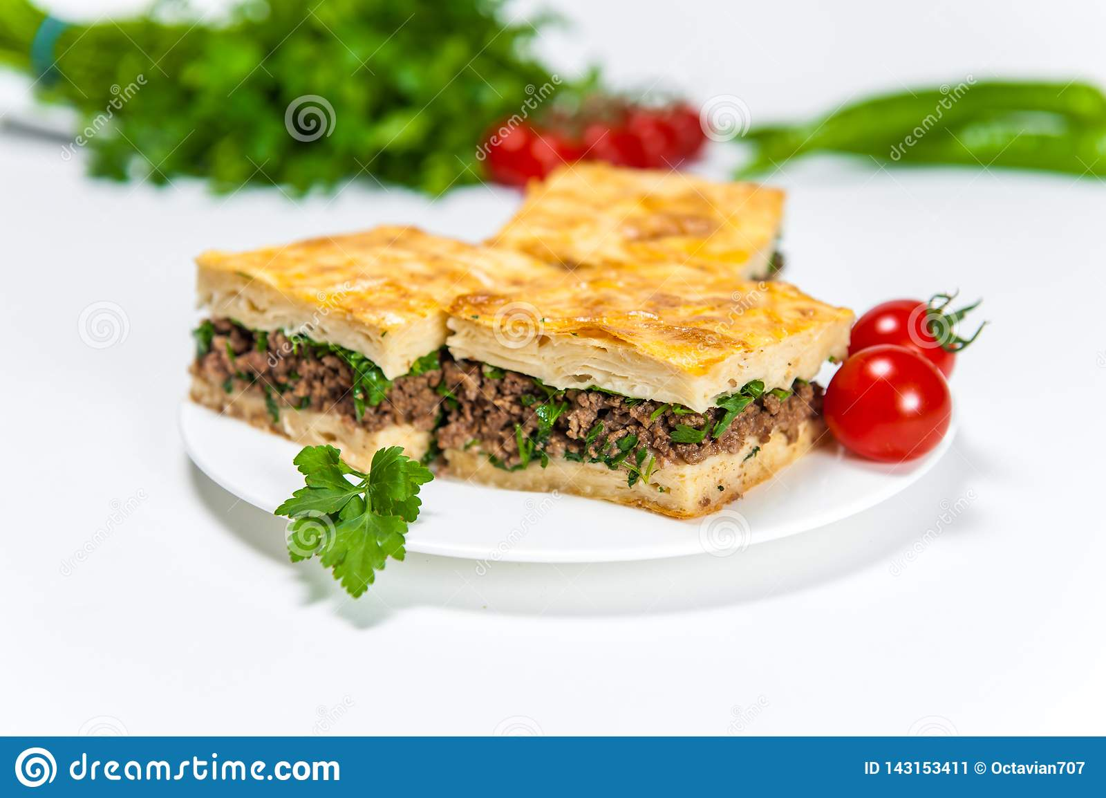 Borek with a lot of meat on white plate