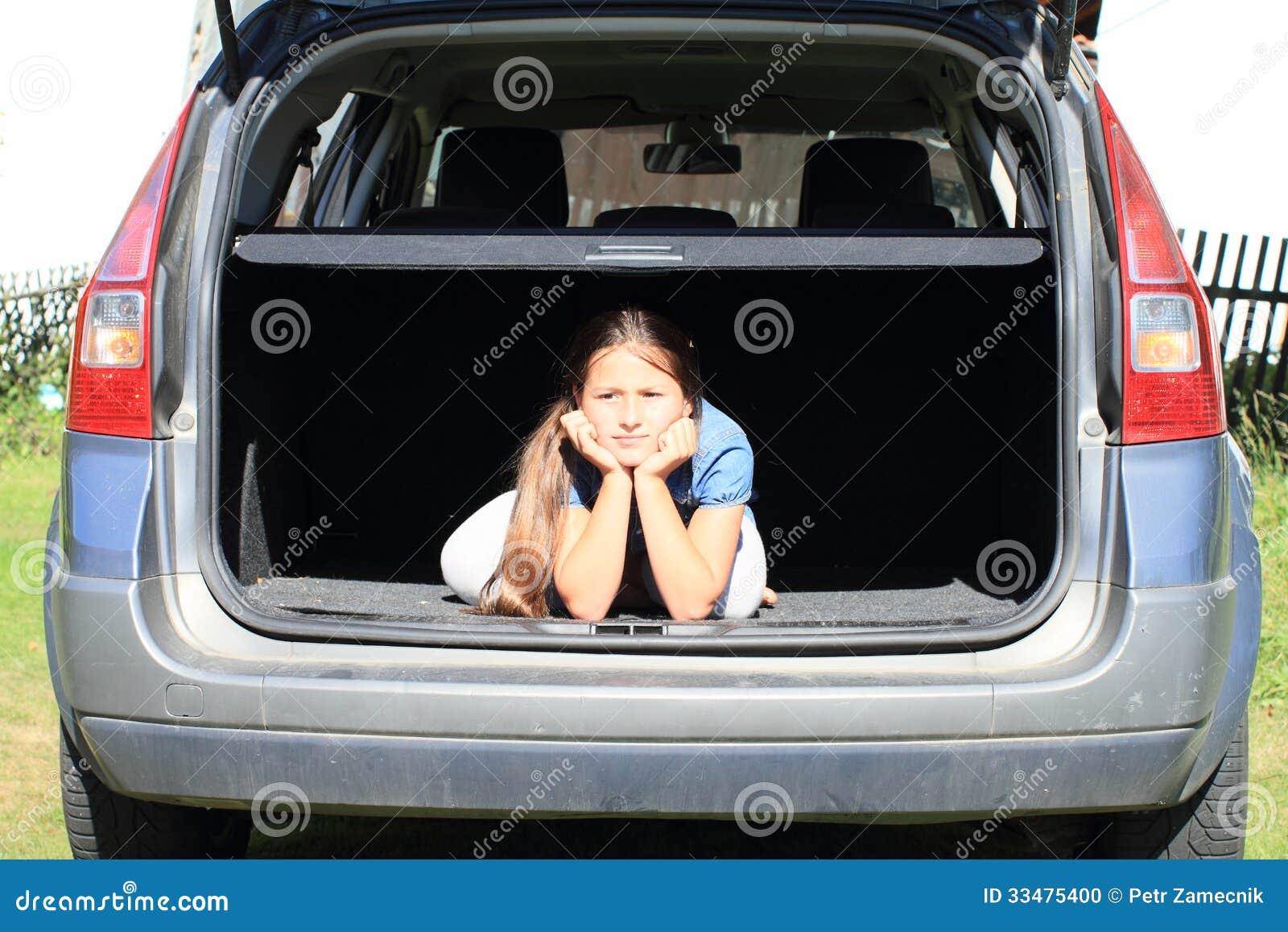 nude in car trunk