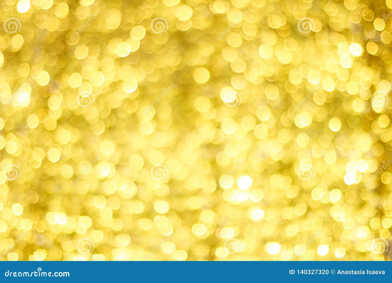 Borrão dourado de Bokeh Luzes de brilho do ouro Círculos de Bokeh