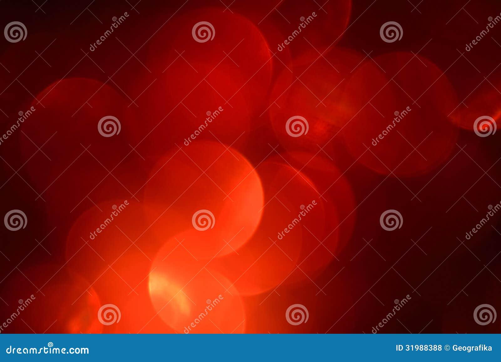 Borrado, fundo das luzes vermelhas do bokeh. Sparkles do sumário