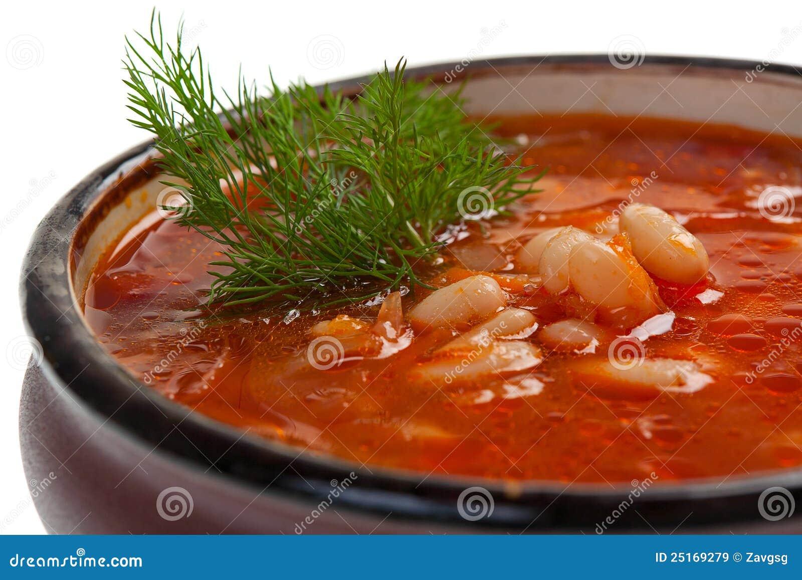 Ukrainian and russian national red soup borsch closeup.