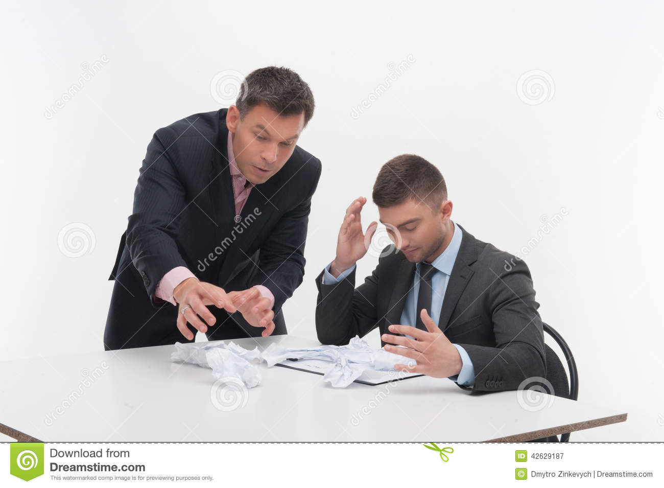 Boss Angry With Young Employee Sitting At Desk Stock Image ...