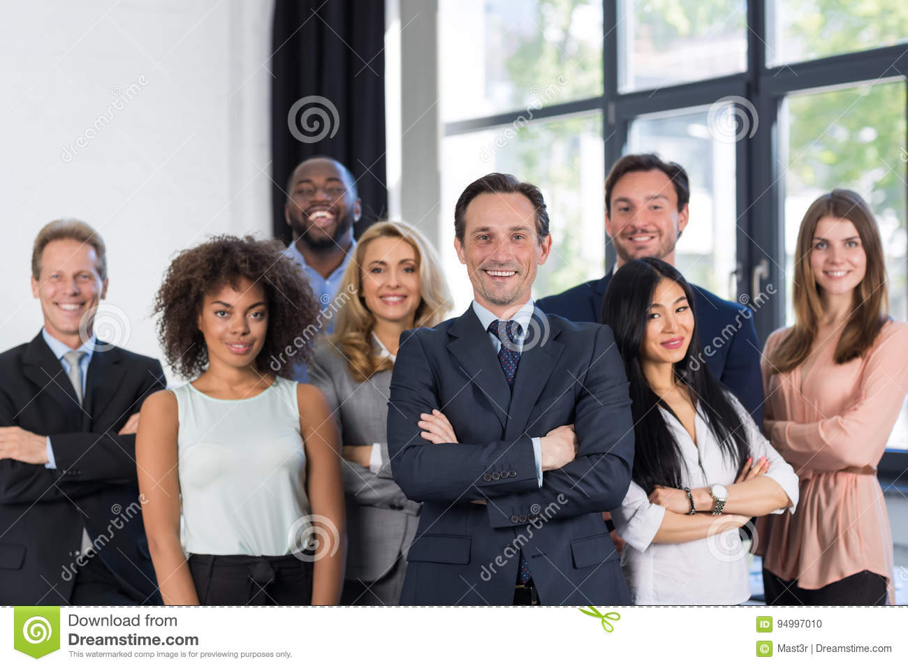 Boss And Business People Group With Mature Leader On Foreground In Office, Leadership Concept, Successful Mix Race Team