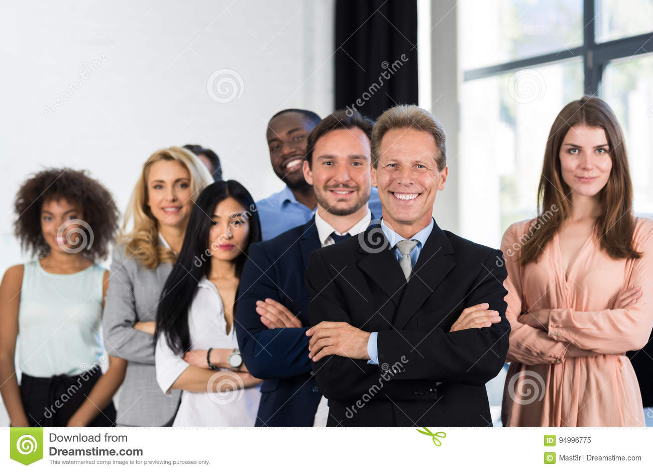 Boss With Group Of Businesspeople In Creative Office, Mature Successful Businessman Leading Business People Team Stand