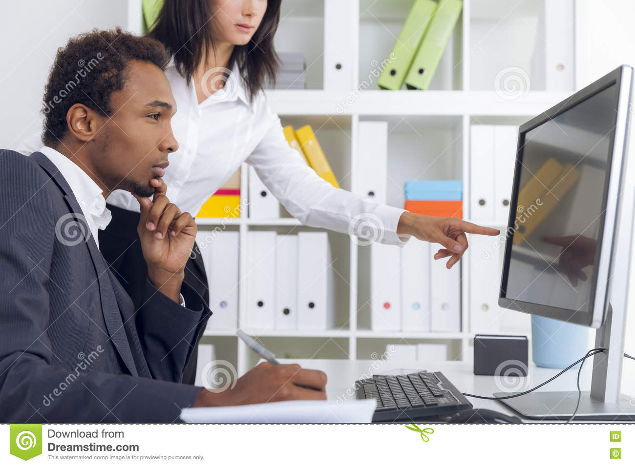 Boss And His Personal Assistant Working Stock Photo