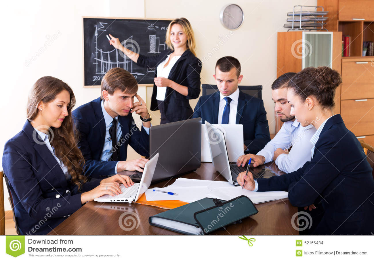 Boss with subordinate officials discussing