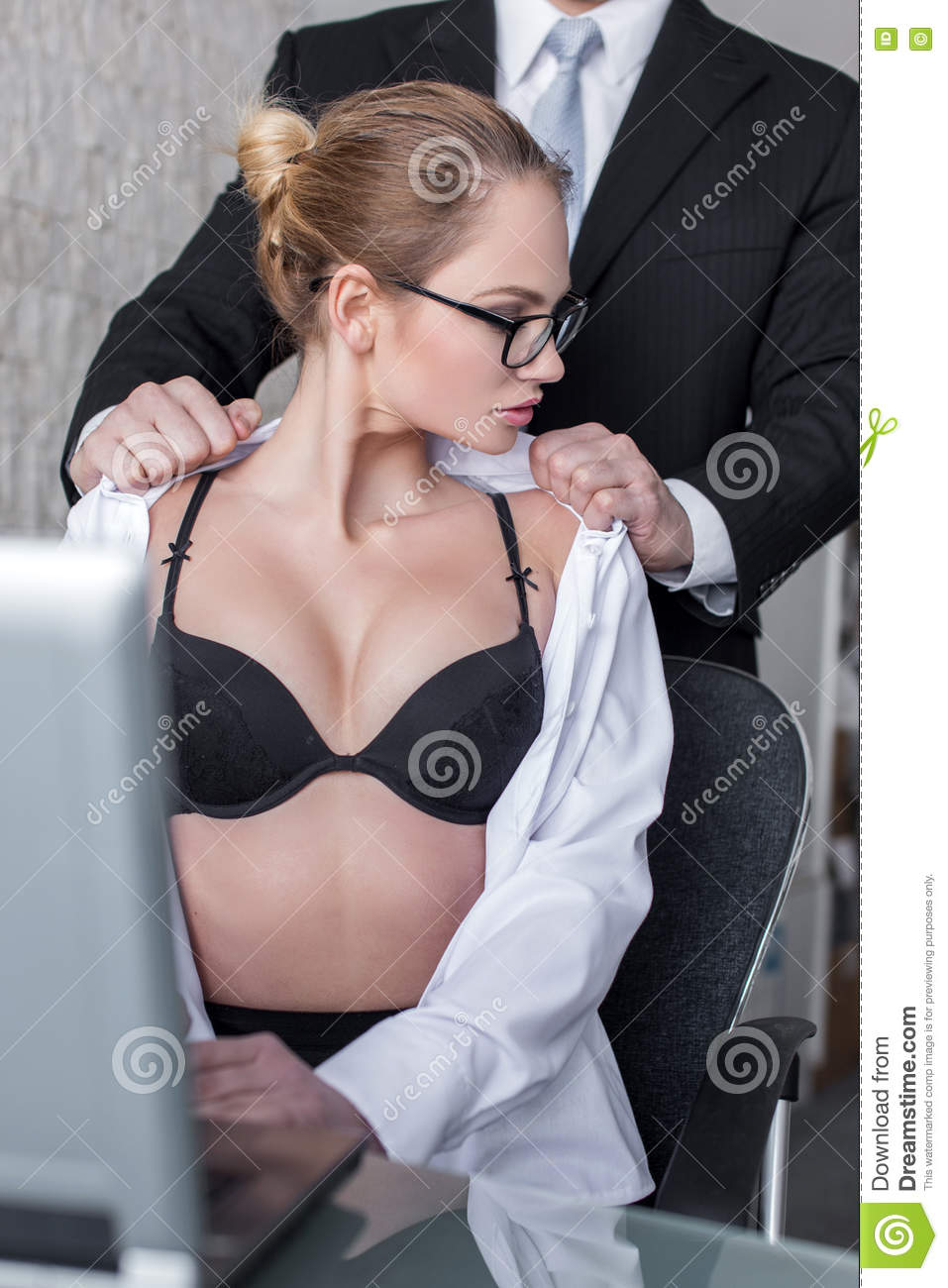boss undressing blonde secretary in office stock photo - image of