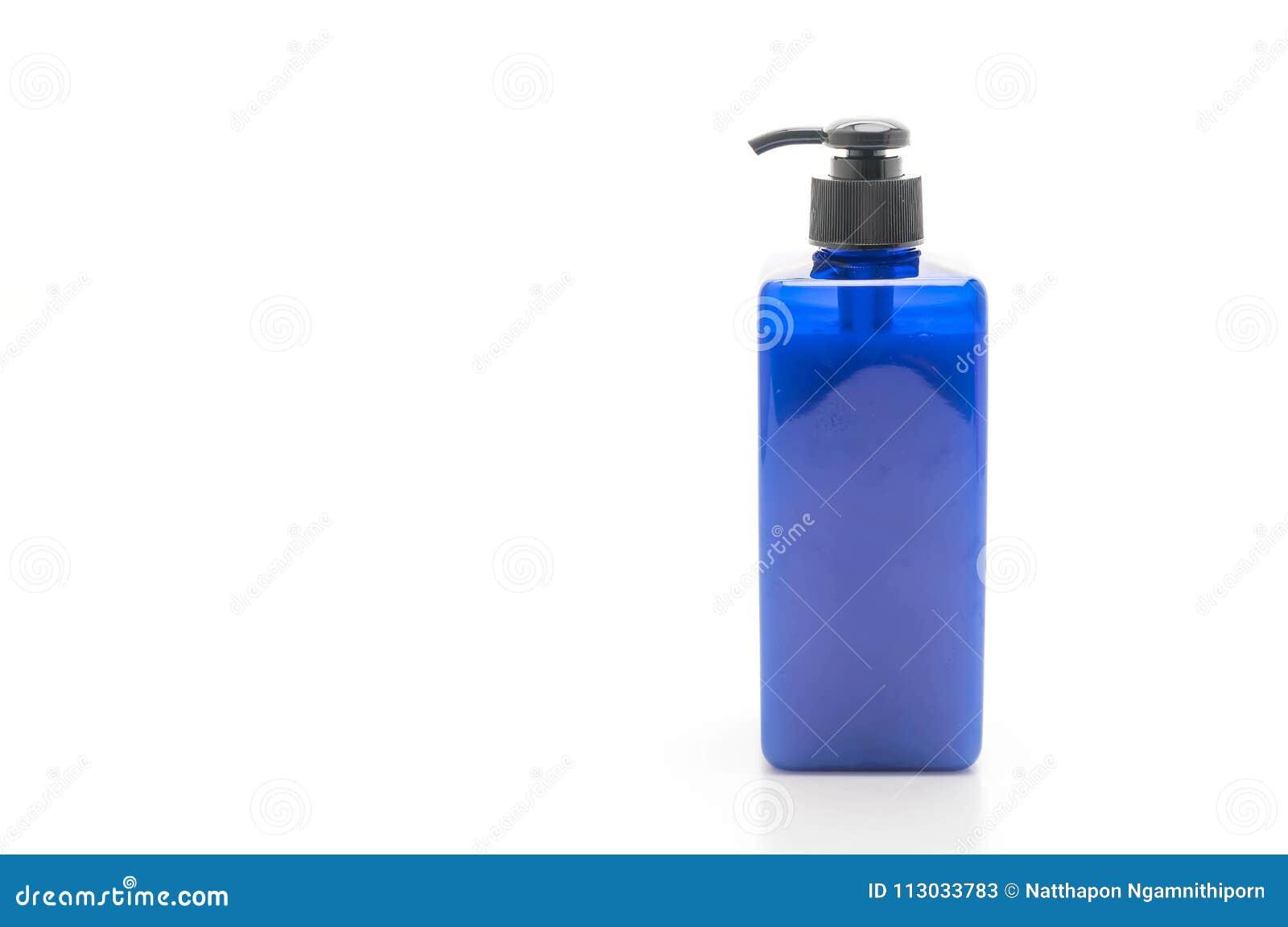 Botella del champú o del jabón en el fondo blanco