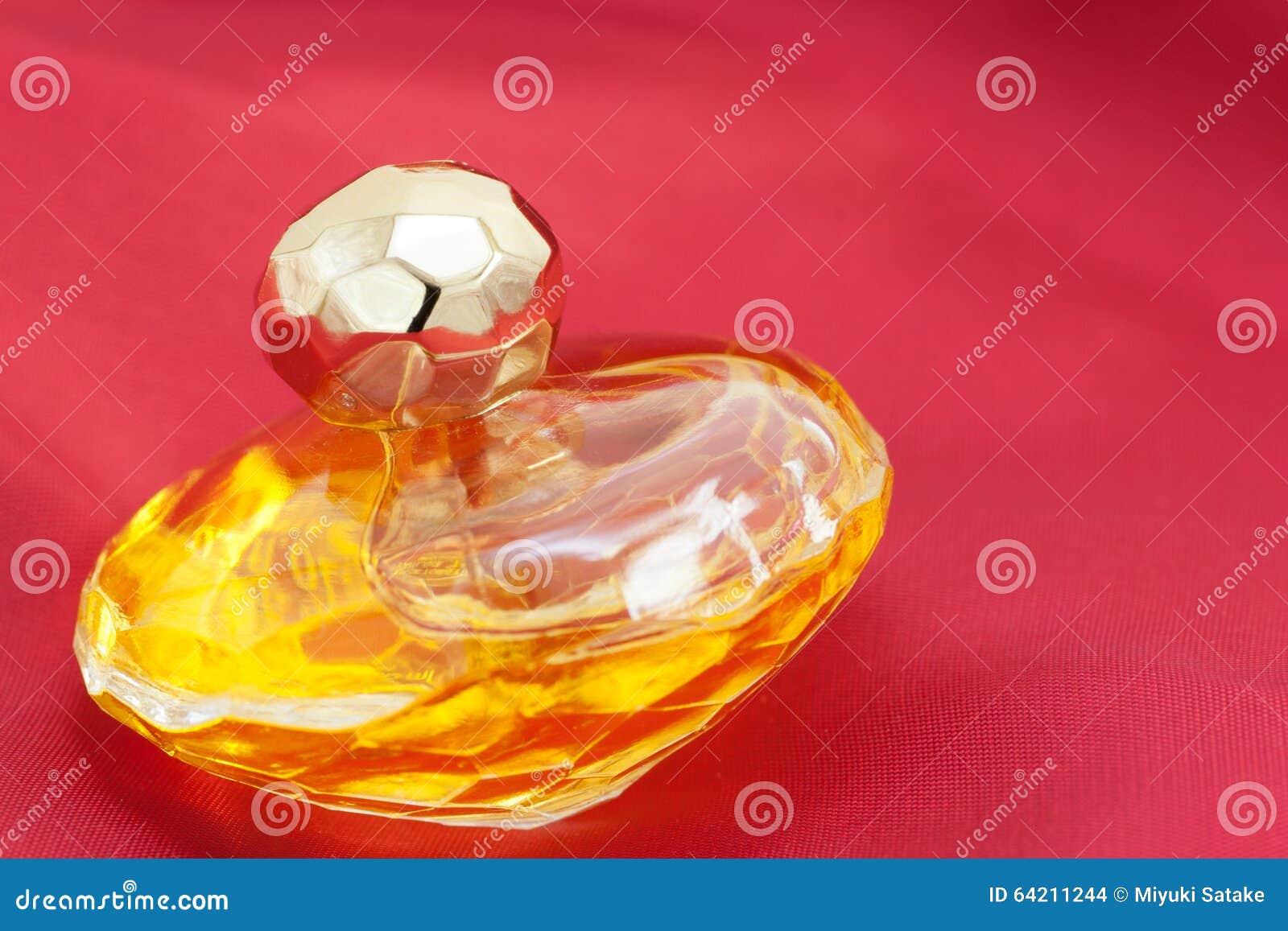 Botella del perfume de oro de Ladys